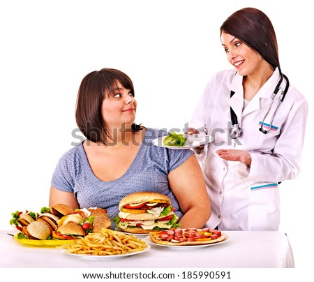 Overweight young woman with hamburger and doctor.