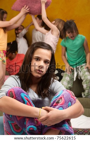 Overwhelmed babysitter with wild little girls at a sleepover - stock photo