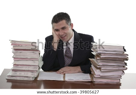 Overwhelmed businessman with stacks of paperwork or files (white background)
