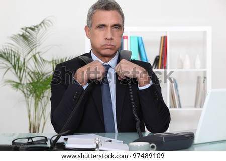 Overwhelmed executive - stock photo