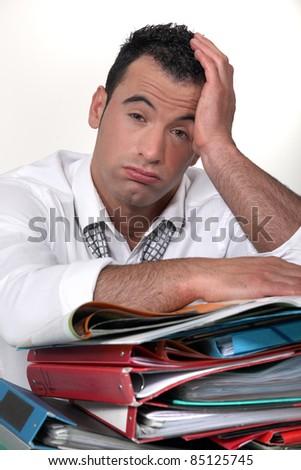 overwhelmed worker - stock photo