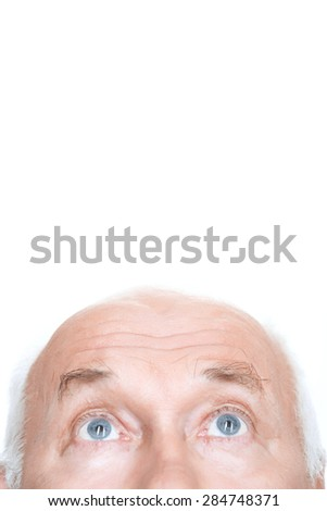 Overwhelming admiration. Agreeable grandfather holding his head and looking up while standing isolated on white background - stock photo