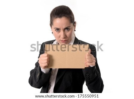overworked business woman wearing a business suit holding a blank sign as copy space on a white background  - stock photo