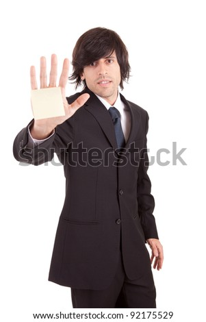 Overworked businessman with yellow sticky reminder note - stock photo