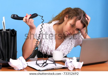 Overworked businesswoman holding telephone handset with unanswered call - stock photo
