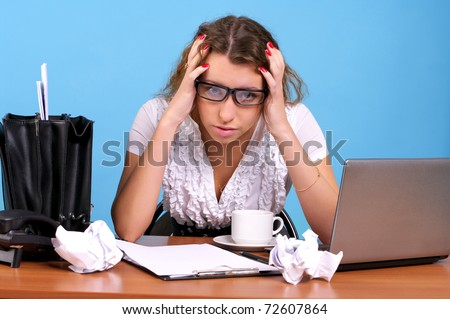 Overworked businesswoman in the office workplace