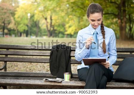 overworked businesswoman on coffee break finishing  her works - stock photo