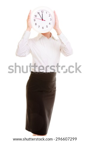 Overworked businesswoman showing clock. Busy woman covering her face isolated on white. Time management. Studio shot. - stock photo