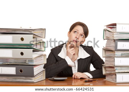 overworked contemplative business woman in office between folder stacks. Isolated on white background. - stock photo