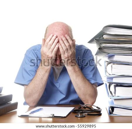 Overworked doctor - stock photo