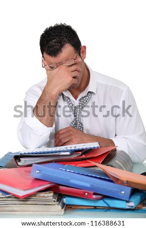 Overworked employee - stock photo