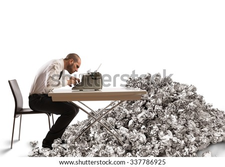 Overworked exhausted businessman writes with a typewriter - stock photo