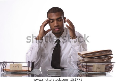 Overworked man frustrated and rubbng head. - stock photo