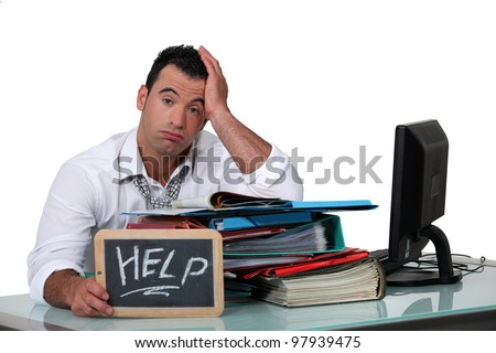 Overworked white collar working crying out for help - stock photo