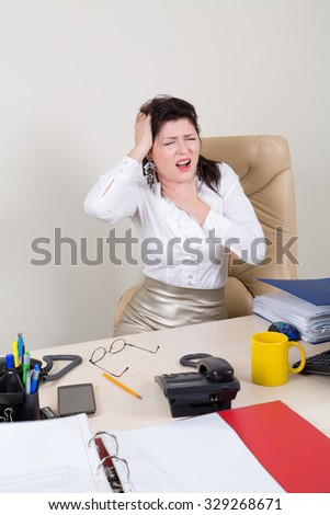overworked woman with pain in office