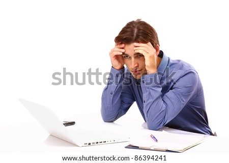 Overworked young man in front of laptop isolated - stock photo