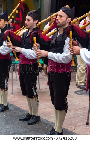 OVIEDO, Spain August 25, 2015: Group of bagpipers to parade through the streets to attract tourism in Oviedo, Spain - stock photo
