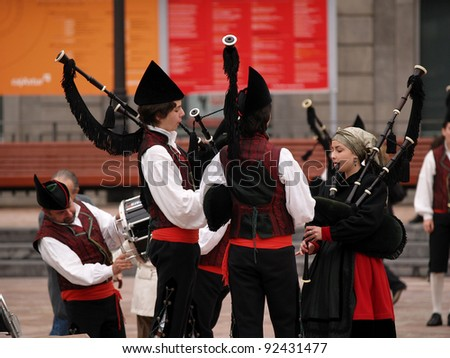 OVIEDO, SPAIN - NOVEMBER 6: Bagpipes Bands play every weekend for tourist in Oviedo, on November 6th, 2010 in Asturias, Spain - stock photo