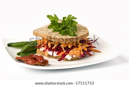 Ovo-lacto vegetarian sandwich, containing: cottage cheese, grated carrot, grated beetroot in a wholegrain bread isolated on white. - stock photo
