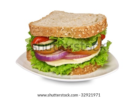 Ovo-lacto vegetarian sandwich isolated on white, containing: cheese, lettuce, tomato, egg, zucchini, ognion and red pepper in a wholegrain bread. It has a clipping path. Selective focus on the front. - stock photo