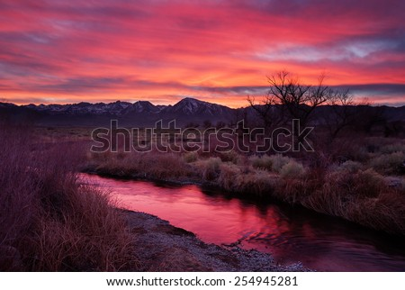 Owens Valley Sunset with reflection in the Owens River - stock photo