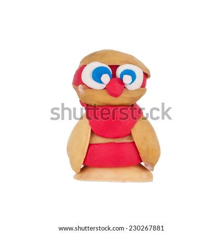 Owl made of plasticine isolated on white background - stock photo