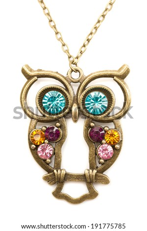 Owl necklace adorned with precious stones. Isolate on white. - stock photo