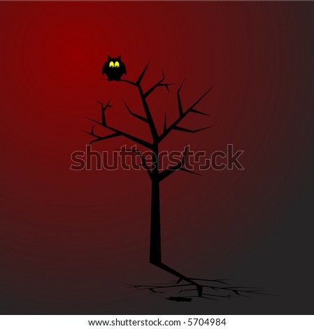 Owl sitting on a tree in spooky surroundings. Concept: Halloween. - stock photo