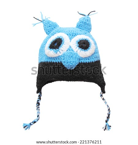 Owl woolen cap for child isolated on white. Crochet handmade cute hat.  - stock photo