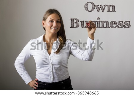 Own Business - Beautiful girl writing on transparent surface - horizontal image