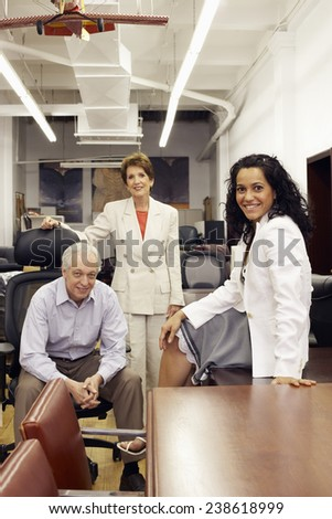 Owner and Staff in Office Furniture Store - stock photo