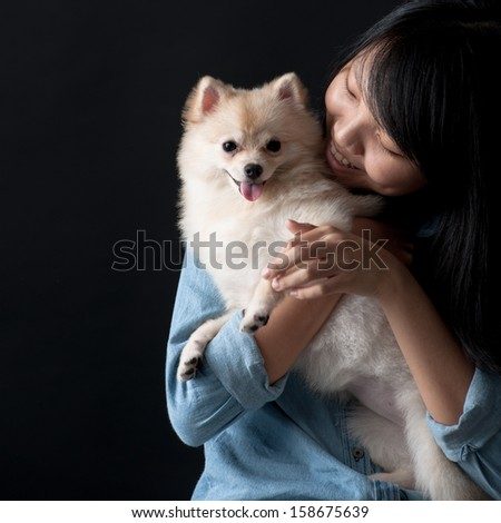 Owner embracing her dog - stock photo