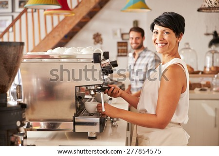Owner helping in cafe - stock photo