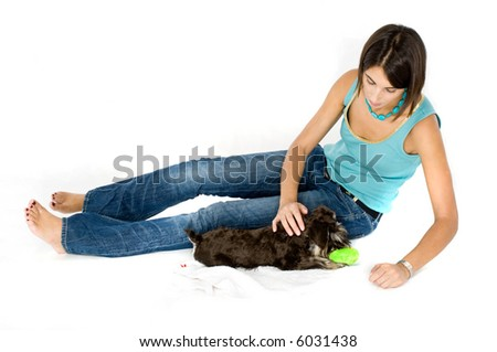 Owner playing with their puppy