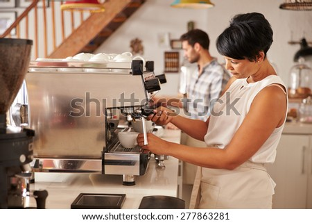 Owner working in her cafe - stock photo