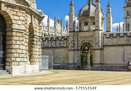 OXFOR, ENGLAND - JULY 11, 2010: Ornamental entrance to All Soul's College with a fragment of Radcliffe Camera on the left on July 11, 2010.