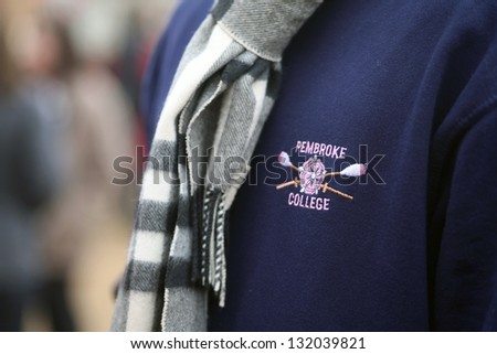 OXFORD - MAR 8: Oxford university student wearing a rowing sweatshirt during Torpids races on March 8, 2013. Torpids are one of annually three races with more than 1,200 participants. - stock photo