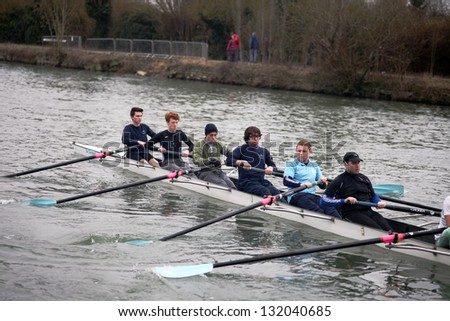 OXFORD - MAR 8: Oxford university students rowing during Torpids races on March 8, 2013. Torpids are one of annually three races with more than 1,200 participants. - stock photo