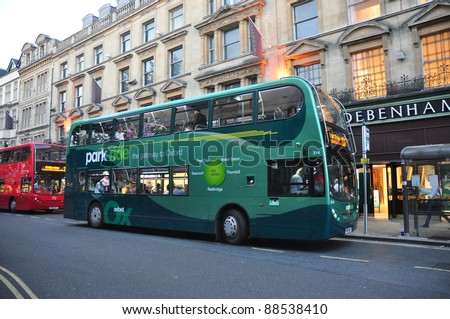 OXFORD – SEPTEMBER 29: An Oxford Park and Ride Bus stopped to fetch passengers  on September 29, 2011 in Oxford, England. Oxford buses start from 6.00 a.m and operate through to 11.30  p.m. everyday.