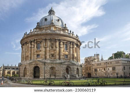 Oxford, UK - August 27, 2014: view of the Radcliffe Camera with All Souls College in Oxford, UK. The historic building is part of Oxford University Library. - stock photo