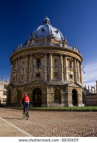 Oxford University Radcliffe Camera building, England, with cyclist passing by. - stock photo