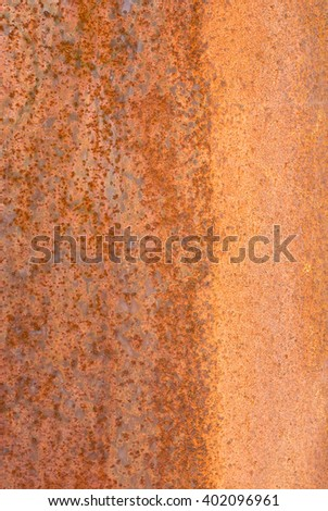 oxidized material - close up of a textured oxidized surface background design - orange and copper - stock photo