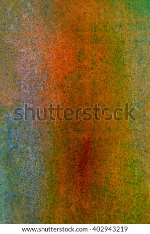 oxidized material - close up of a textured oxidized surface background design - yellow orange and green - stock photo