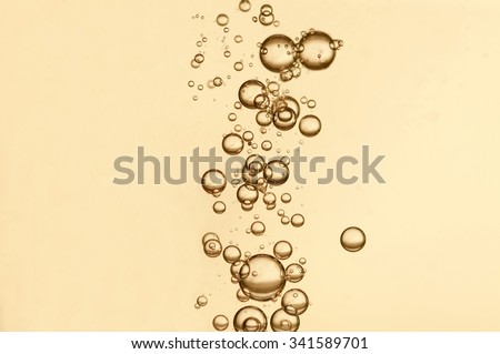 Oxygen bubbles in a champagne glass - stock photo