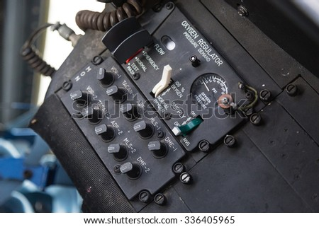 Oxygen Regulator in a Cockpit of an Airplane
