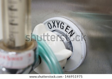 oxygen supply on the wall with focus on the word 'oxygen' - stock photo
