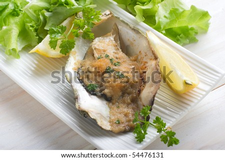 oyster au gratin with salad - stock photo