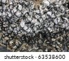 Oyster shells on rock by the sea - stock photo