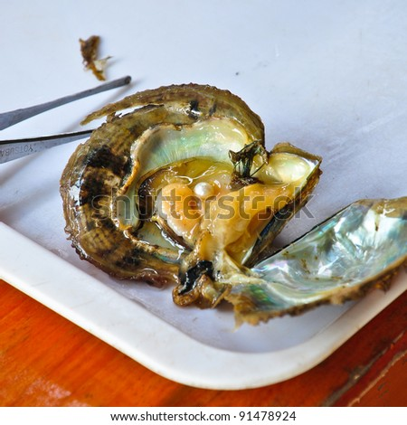 Oyster with pearl - stock photo