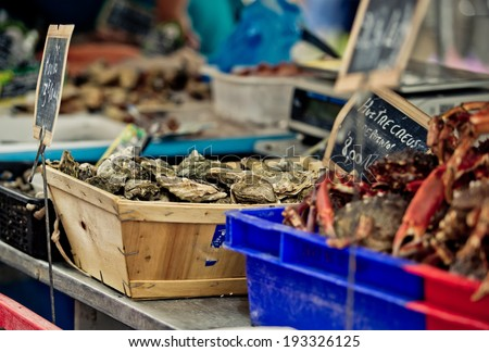 Oysters at a local Weekly Market in Brittany France - stock photo